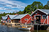 Typical red boathouses by the sea near Härnösand, Västernorrland, Sweden