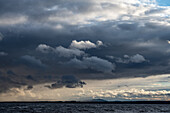 Dark clouds and intense light at Lake Siljan, Rättvik, Dalarna, Sweden