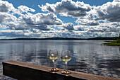 Two wine glasses on the railing at Lake Siljan near Sollerön, Dalarna, Sweden