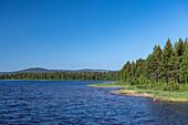 Perfect blue sky over the wide landscape at Lake Siljan, Dalarna, Sweden