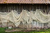 Fishing nets hanging on a wooden hut, Dießen, Diessen, Ammersee, Bavaria, Bayern, Deutschland, Germany, Europe