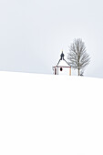 View of a chapel in the snow and in snowfall, Allgäu, Bavaria, Germany, Europe,