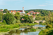 River landscape in the valley of the Wörnitz near Harburg with the Herz-Jesu Church in the background, Swabia, Bavaria, Germany