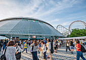 Local visitors in front of the Tokyo Dome Arena, Tokyo, Japan