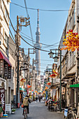 Street scene of a normal residential area in Asakusa with the Skytree Tower in the background, Tokyo, Japan