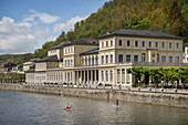 Stand-up paddler (SUP) on the Lahn in front of the casino in Bad Ems, UNESCO World Heritage Site 'Major Spa Towns of Europe', Rhineland-Palatinate, Germany