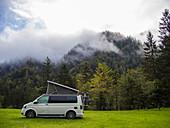VW bus on a meadow in Carinthia, Austria