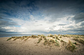 Sand dunes on the North Sea under storm clouds, Schillig, Wangerland, Friesland, Lower Saxony, Germany, Europe