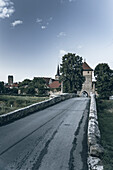 Bridge over the Rodach with a view of the Rothenberger city gate and the medieval town of Seßlach in the Upper Franconian district of Coburg