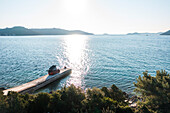 Road trip Croatia, with the camper on a jetty on the coast