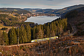 View over the Titisee with regional train, Southern Black Forest, Black Forest, Baden-Wuerttemberg, Germany, Europe