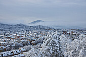 View from Schlossberg over Freiburg towards Schönberg with St. Johannes Church in the snow, Freiburg, Breisgau, Southern Black Forest, Black Forest, Baden-Wuerttemberg, Germany, Europe