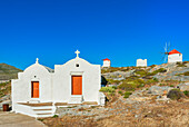 View of Orthodox chapel and traditional windmills, Chora, Amorgos, Cyclades Islands, Greece
