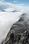 Ridge surrounded by fog at Steintalhörnl, Berchtesgaden Alps, Bavaria, Germany
