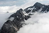 The Hocheisspitze in the fog, Berchtesgaden Alps, Bavaria, Germany