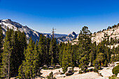 View of the famous Half Dome and the striking granite rocks of Yosemite National Park in the USA