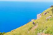 People walking on La Rocca trail, Cefalu, Sicily, Italy, Europe