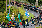 Men of Lonach parade, pipe band in highland dress, Strathdon, Aberdeenshire, Scotland UK