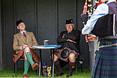 Judges listening to bagpipers, Highland Games, Blair Castle, Perthshire, Scotland, UK