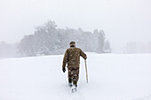 Walkers in front of Balmoral Castle in the snow, Royal Deeside, Aberdeenshire, Scotland, UK