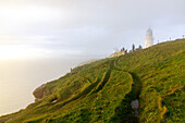 Dunnet Head lighthouse in the sea mist, Caithness, Scotland's northernmost point, UK