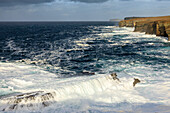 Cliffs and surf breakers on the coast of Yesnaby, Atlantic Ocean, Orkney, Scotland UK