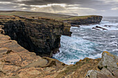 Storm, surf breaker, sandstone cliffs of Yesnaby, clusters of rays, Orkney, Scotland UK