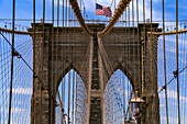 The ropes of the bridge tower of the Brooklyn Bridge in New York are attached symmetrically