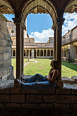 Young people in the Cordeliers Cloister monastery in the wine town of Saint Emilion, Unesco World Heritage, France