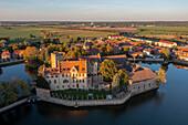 Flechtingen moated castle in the evening sun, built in the 13th century, Flechtingen, Saxony-Anhalt, Germany