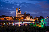 Magdeburg Cathedral at dusk, in front of it the illuminated Elbe promenade, party tent on the riverside, Magdeburg, Saxony-Anhalt, Germany
