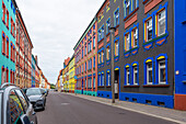 Colorful house facades in Otto-Richter-Strasse, designed according to plans by Carl Krayl in 1920, Neues Bauen, Magdeburg, Saxony-Anhalt, Germany