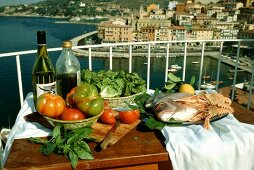 Still life; fish; tomatoes; balcony; Italy