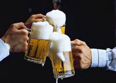 Three tankards of light beer