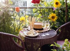 Small Rattan Table on a Flowery Terrace; Wine