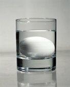 Fresh egg in glass of water (freshness test)