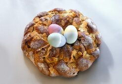 Bread Easter wreath, with three Easter eggs in the middle