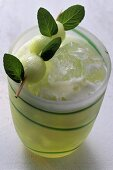 Melon juice in a glass with ice cubes