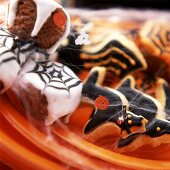 Muffins with cobweb icing and biscuits for Halloween