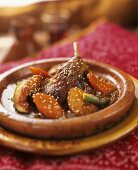 Duck confit tajine with figs, apricots and sesame