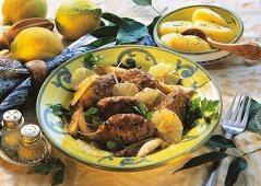 Beef dumpling with lemon sauce and lemon slices