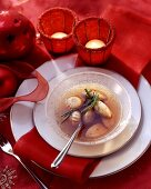 Bouillon with cep dumplings and button mushrooms