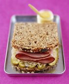 Wholemeal sandwich with pickled gherkins, sauerkraut & ham