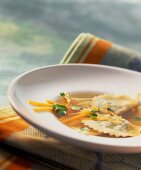 Vegetable broth with filled pasta parcels