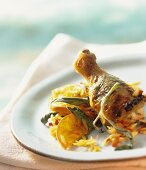 Chicken leg with oranges and rice noodles