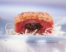 Raw tuna stuffed with plums, with bonito flakes