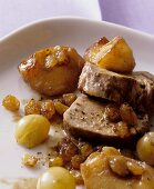 Pork fillet mignon with apples, grapes and raisins