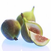 Three figs, one cut open