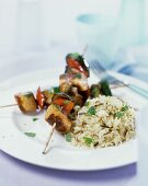 Sausage and vegetable kebabs with wild rice