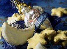 Cinnamon stars and moons and a Christmas tree ornament